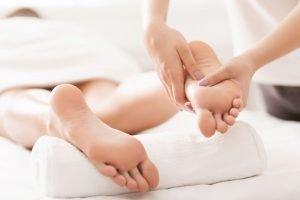 Acupressure And Reflexology Concept. Masseur Doing Foot Massage