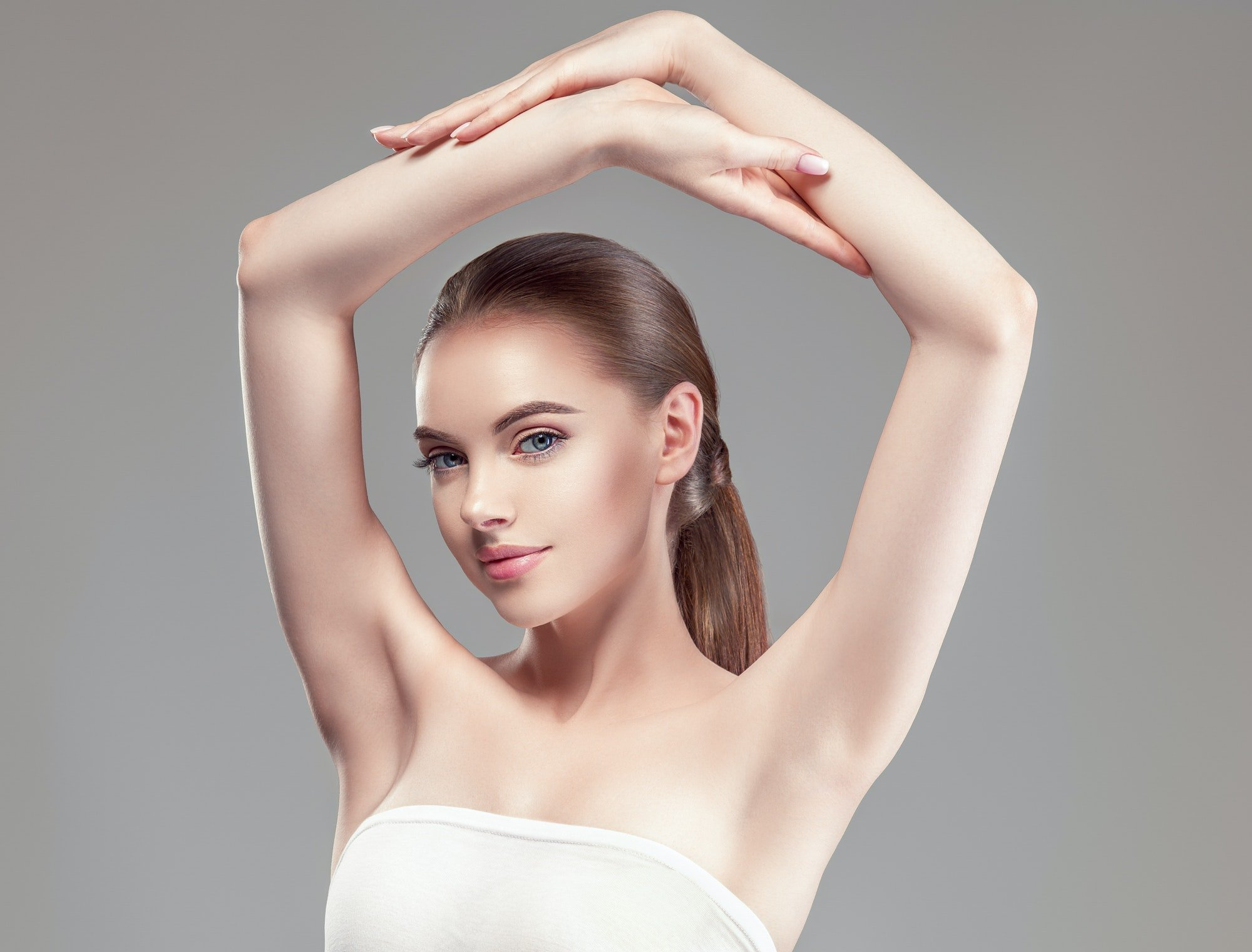Armpit woman hand up care depilation concept
