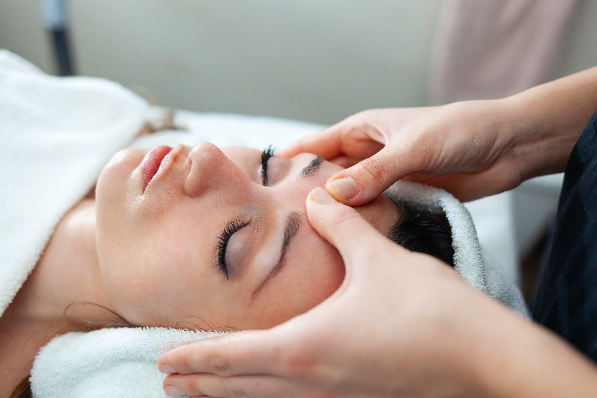 Facial massage at spa.